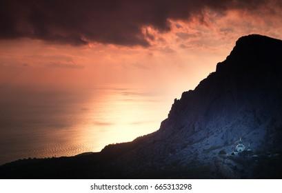 Small church under a mountain at sunset. Foros. Crimea.