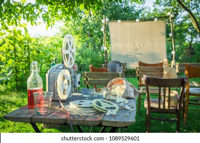 Small cinema with drinks and popcorn in summer garden