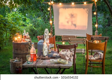 Small cinema with retro projector in the evening