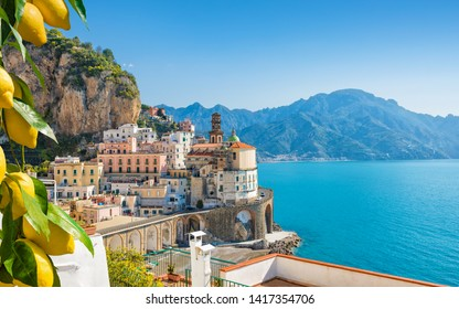 Small city Atrani on Amalfi Coast in province of Salerno, Campania region, Italy. Amalfi coast on Gulf of Salerno is popular travel and holyday destination in Italy. Ripe yellow lemons in foreground.