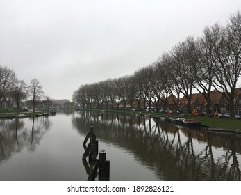 Small city singel boat christmas tree clouds