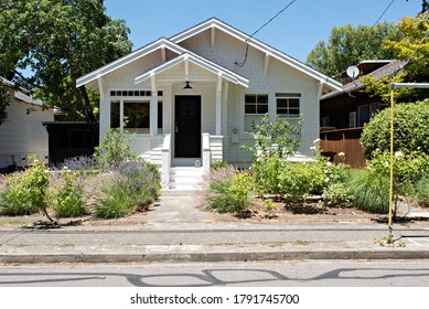 Small Classic White Shingle House in the Neighborhood