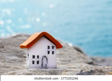 Small clay houses European style, softfocus. White walls and orange roof, outdoors by the sea, handmade and handpainted myself - therefore unique photo's, several available.