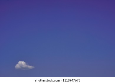 Small cloud on the clear sky, metaphor of unproblematic future. Abstract nature background.