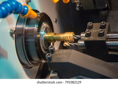 The small CNC lathe multi function for hi-precision manufacturing.The brass rod part machining process.
