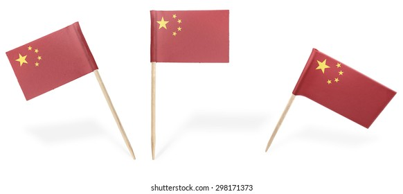 Small cocktail flags of China in different positions isolated on white.(series) . Also easy to use as a design element :)