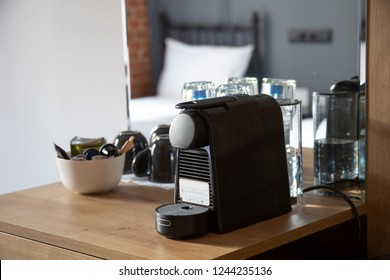 Small coffee machine with capsule coffee/ tea supplies in a hotel room