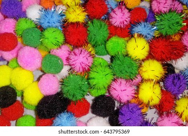 Small colored pompons