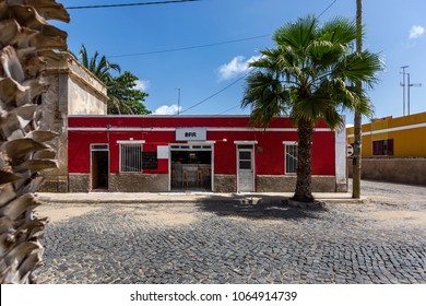 Small colorful buildings surrounded by palm trees in Santa Maria, Sal, Cape Verde, Cabo Verde