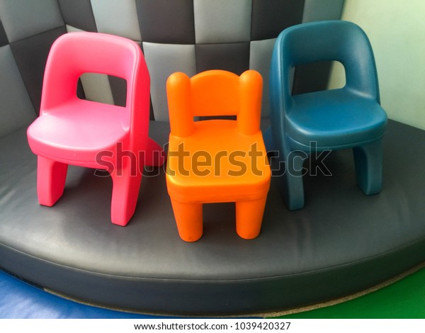 Small and colorful chairs for little kids in room