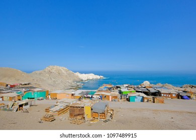 Small colorful fishing village on the pacific coast, south of Iquique, Chile, South America