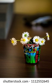 small colorful glass with camomille flowers ,decoration
