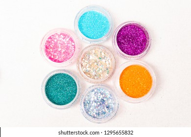 small colorful jars of glitter and sequins for body tattoo close-up