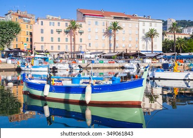 Small colorful wooden fishing boat moored in old port of Ajaccio, Corsica, France