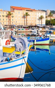 Small colorful wooden fishing boats moored in old port of Ajaccio, Corsica, France