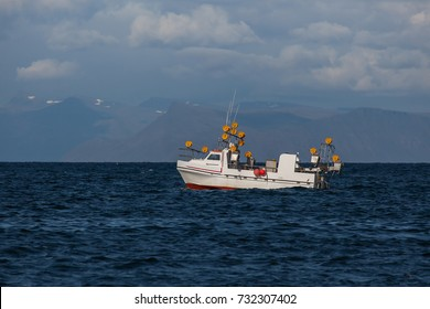 Small commercial fishing boat at mackerel fishing in Icelandic waters.