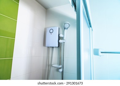 Small and compact bathroom, hot shower and shower head