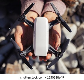 Small compact drone in womans hands