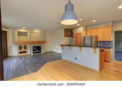 Small compact kitchen room with light wood cabinetry, Quartz counters and dining area.