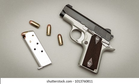 Small Conceal Carry Handgun with ammo and magazine