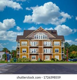 Small Condo Building Under Blue Skies in Canada