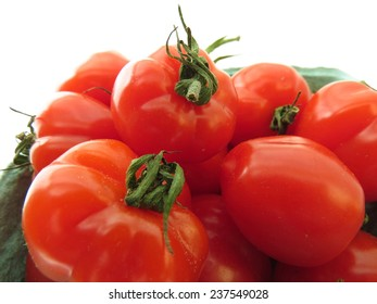 Small container of bright red strawberry tomatoes