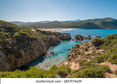 A small cove and turquoise Mediterranean and Ostriconi beach in the Balagne region of Corsica