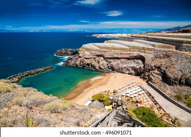 small cozy Abama beach and banana plantations on the background, Tenerife, Canary islands