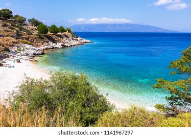 Small cozy beach with white sand and azure water