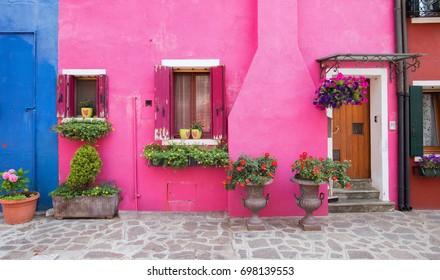 Small, cozy courtyard with colorful cottage /  Burano, Venice/ The small yard with bright walls of houses