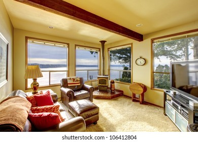 Small cozy living room with TV and water view.