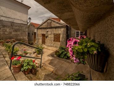 A small cozy patio. Flowers. The village of Combarro Galicia
