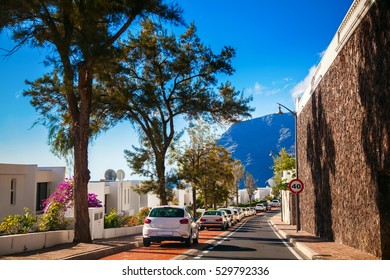 small cozy street with parked cars in Los Gigantes residential area, Tenerife, Canary Islands, Spain