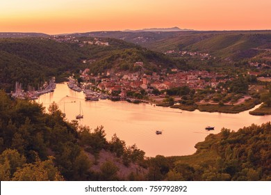 Small cozy town of Skradin on Krka river in sunset light, the entrance to the Krka National Park, Dalmatia, Croatia