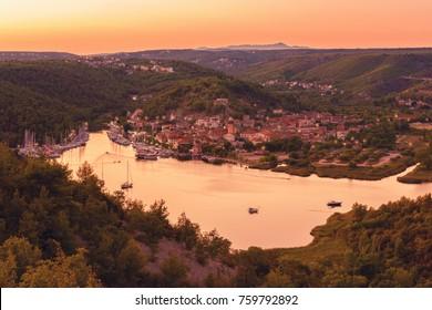 Small cozy town of Skradin on Krka river in sunset light, the entrance to the Krka National Park, Dalmatia, Croatia