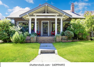 Small craftsman style American old house with front porch.