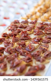 small croutons of bread with slices of bresaola, tasty appetizers