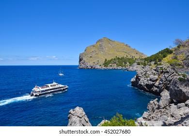 Small cruise ship near the Sa Calobra coast of the island of Majorca