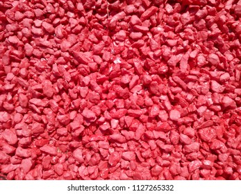 Small crushed stone. A stone crumb. Red texture.