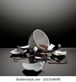 small cup of coffee on a broken dish
