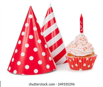 Small cupcake with candle and red party hat