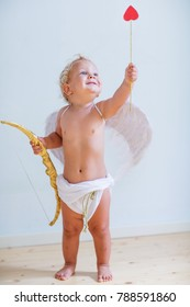 Small cupid is posing to the camera