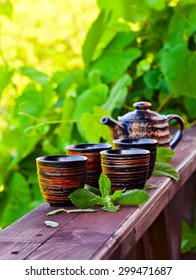 small cups with peppermint tea in garden