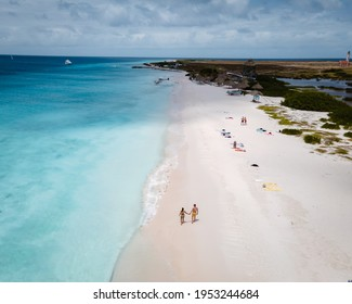 Small Curacao Island famous for day trips and snorkeling tours on white beaches blue clear ocean, Curacao Island in the Caribbean sea. a couple of men and woman on the beach during a vacation holiday