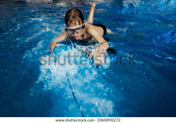 small cute boy in swimming pool