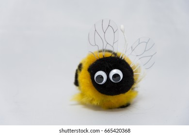 small cute bumble bee plush toys in a white background