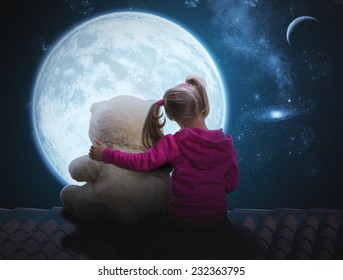 Small cute girl sitting with toy bear