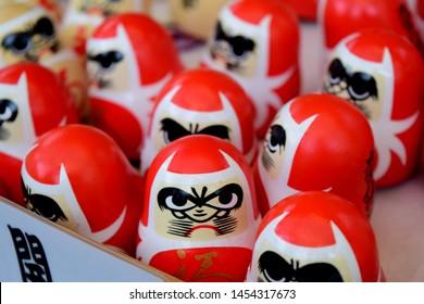 "Small Daruma dolls at Japanese shrine. ""Daruma"" is Japanese traditional doll."