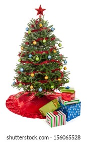 Small decorated real Christmas tree with presents isolated on a white background