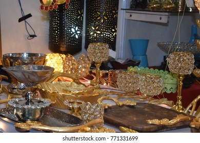 Small decorative beautiful gold and glass items in shop.